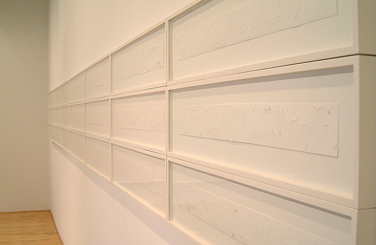 "<i>December Seeder</i>, (36 panels), paper, thread, h. 3"" x w. 30"" (whole unit framed: h. 24"" x w. 420""), 2004"