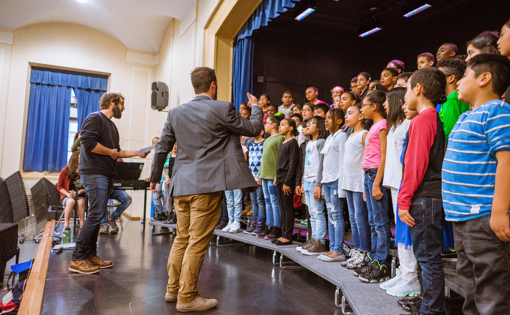 Josh Groban performs with the P.S. 91x Select Choir under the direction of Mr. Quirion.