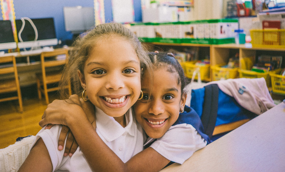 Students at P.S. 91x are happy to see their friends again.