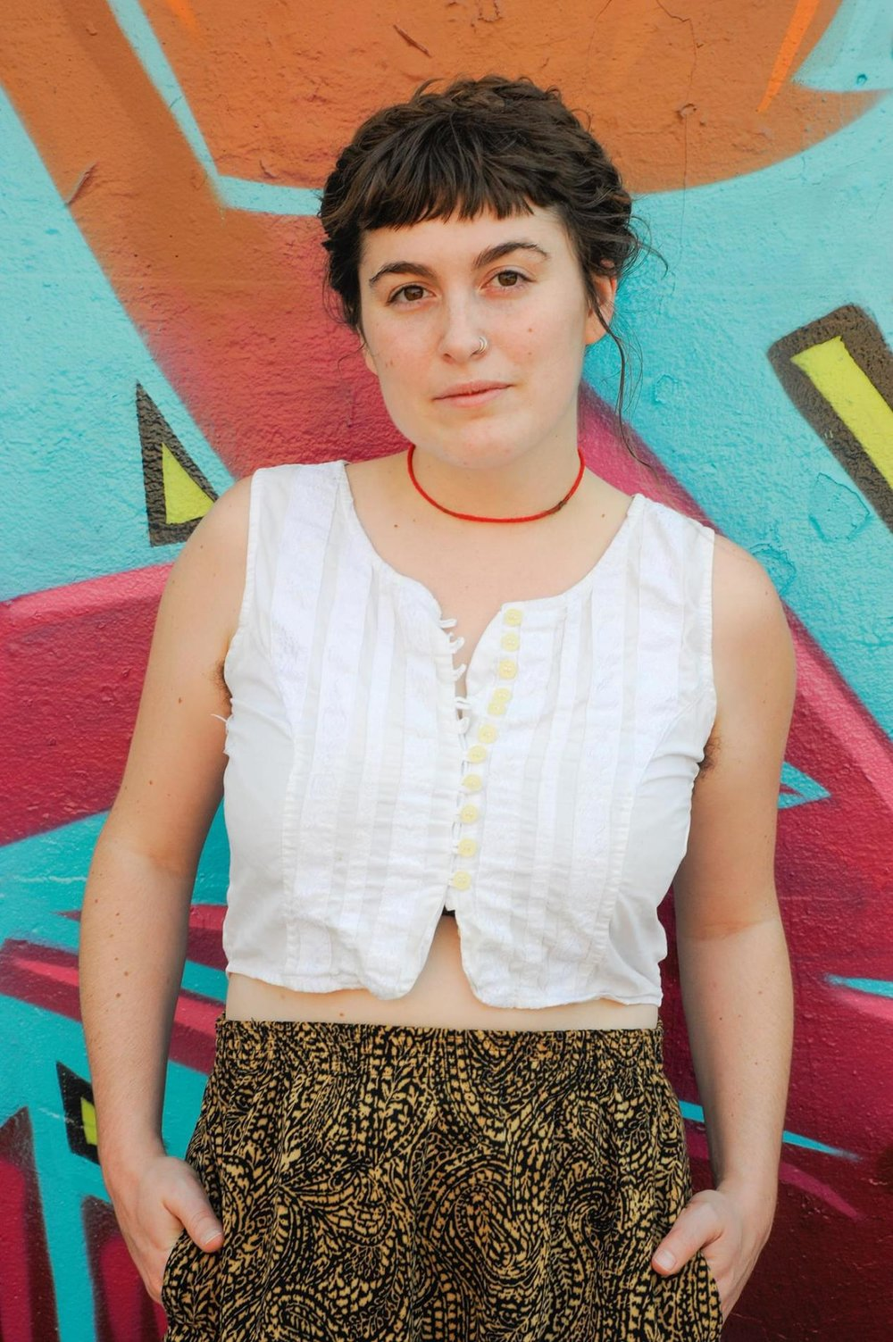 Allison Clendaniel, artistic director   Allison Clendaniel is an interdisciplinary artist reborn in Baltimore, MD. Her work encompasses sound, extended vocal technique, performance art, movement, and theatre.   A versatile improviser, Allison has composed and performed music for voice, synthesizer, piano, computer, cello, and theremin in both solo and collaborative environments. She currently focuses her artistic attention at the intersectionality between technology and acoustic instruments. She has studied voice and movement with legendary performer and composer, Meredith Monk at the House Foundation, clowning with Globus Hystericus, and has toured extensively through North America as a teacher and performing artist.   She tries to build beautiful things around her, crafting songs, making theatre, and working permanently with Nudie Suits, The Flowery, In the Womb of the Everywhere Room, Feral Woman, and Mind On Fire. For more information, please visit  www.allisonisonline.com .