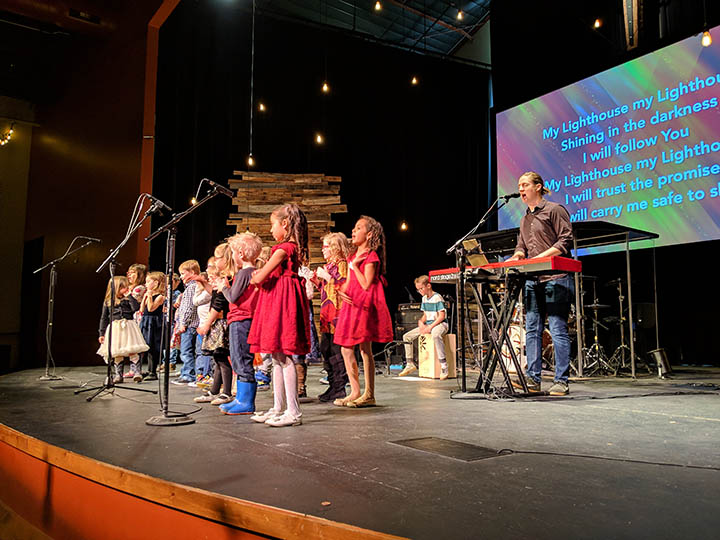 Leading worship at a Sunday morning service