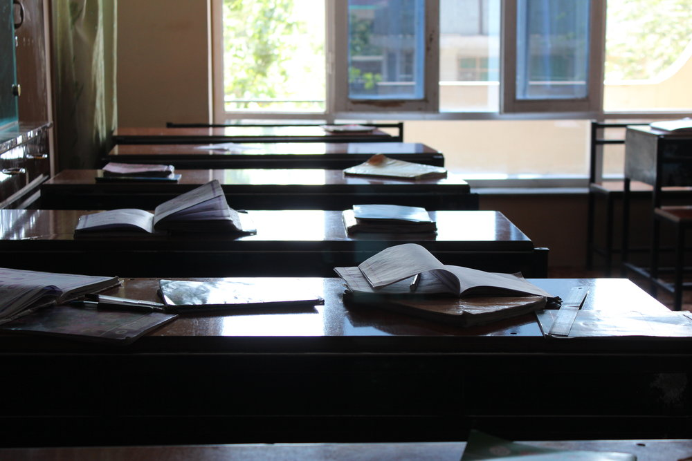 Empty schoolroom with books on tables