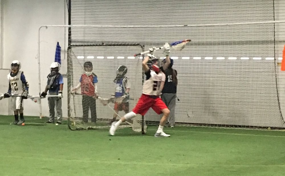 Ben Tompkins, Freedom 2021/Coatesville, making a save during the full-field fast break drill to end the session.