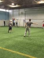 The coaches directing the goalies through a series of stations.
