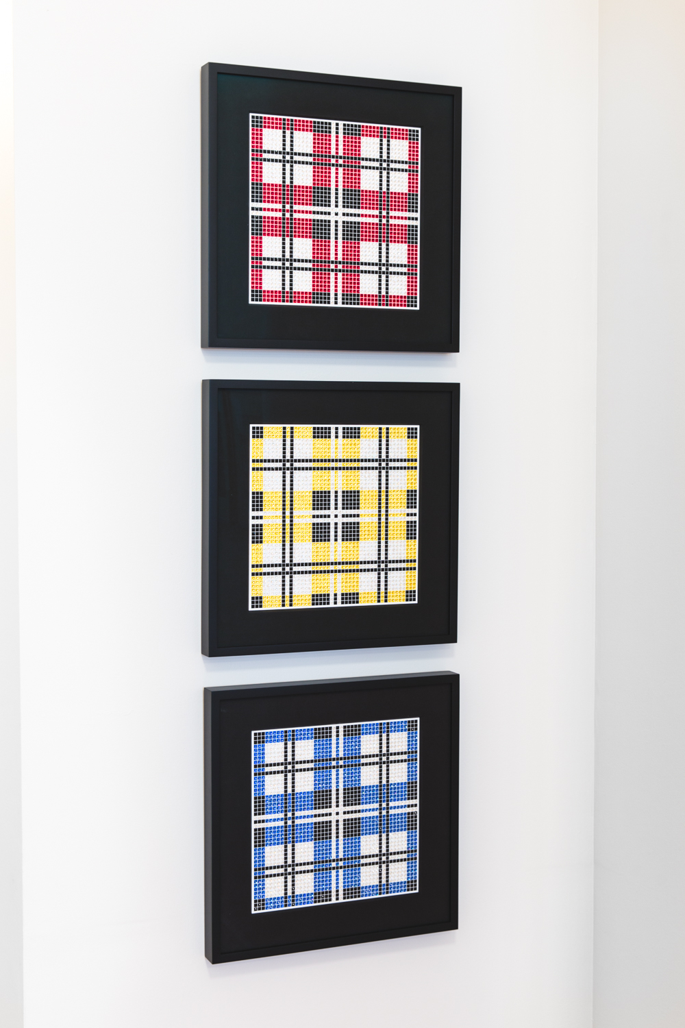 Tartans Dark Red, Yellow, and Blue are boldly graphic when hung together