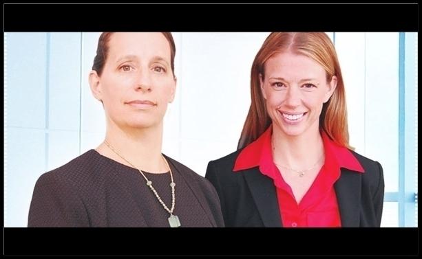 Keli Reynolds, right, with her law partner Susanne Olmos.
