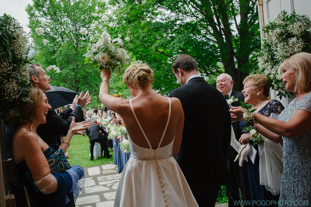 Notice a change here? In the time it took to get guests out of the church and armed with flowers for the send off we were able to get Hayley to a back room where her incredible stylists removed her veil and gave her a complete hair transformation. It was tight but we did it!