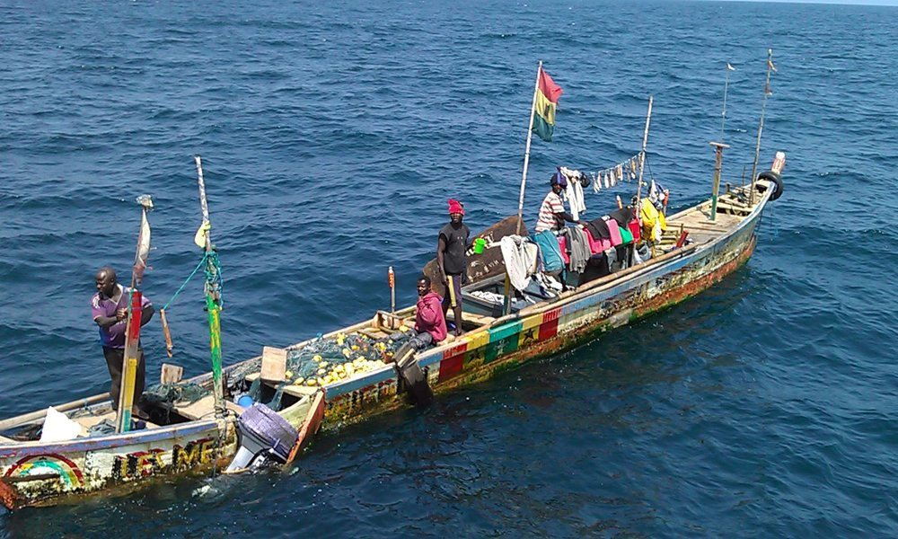 Ghanian fishermen in dugout canoe.jpg