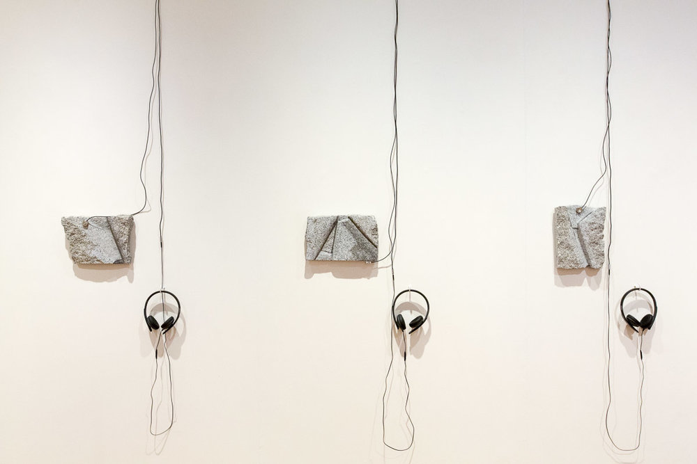 Fayen d'Evie and Bryan Phillips, 'Reading 'Sequence' / Tactile Re-call' 2018. Granite, contact microphones, headphones.