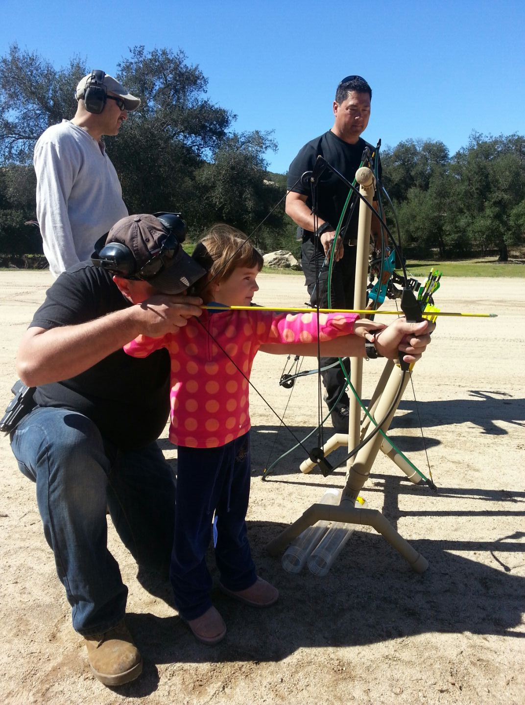 Selfie Sticks vs. Outdoors....a Mother's reflection on her daughters upbringing. Daddy teaching archery. https://reelcamogirl.wordpress.com/2015/01/29/selfie-sticks-vs-outdoors-a-mothers-reflection-on-her-daughters-upbringing/