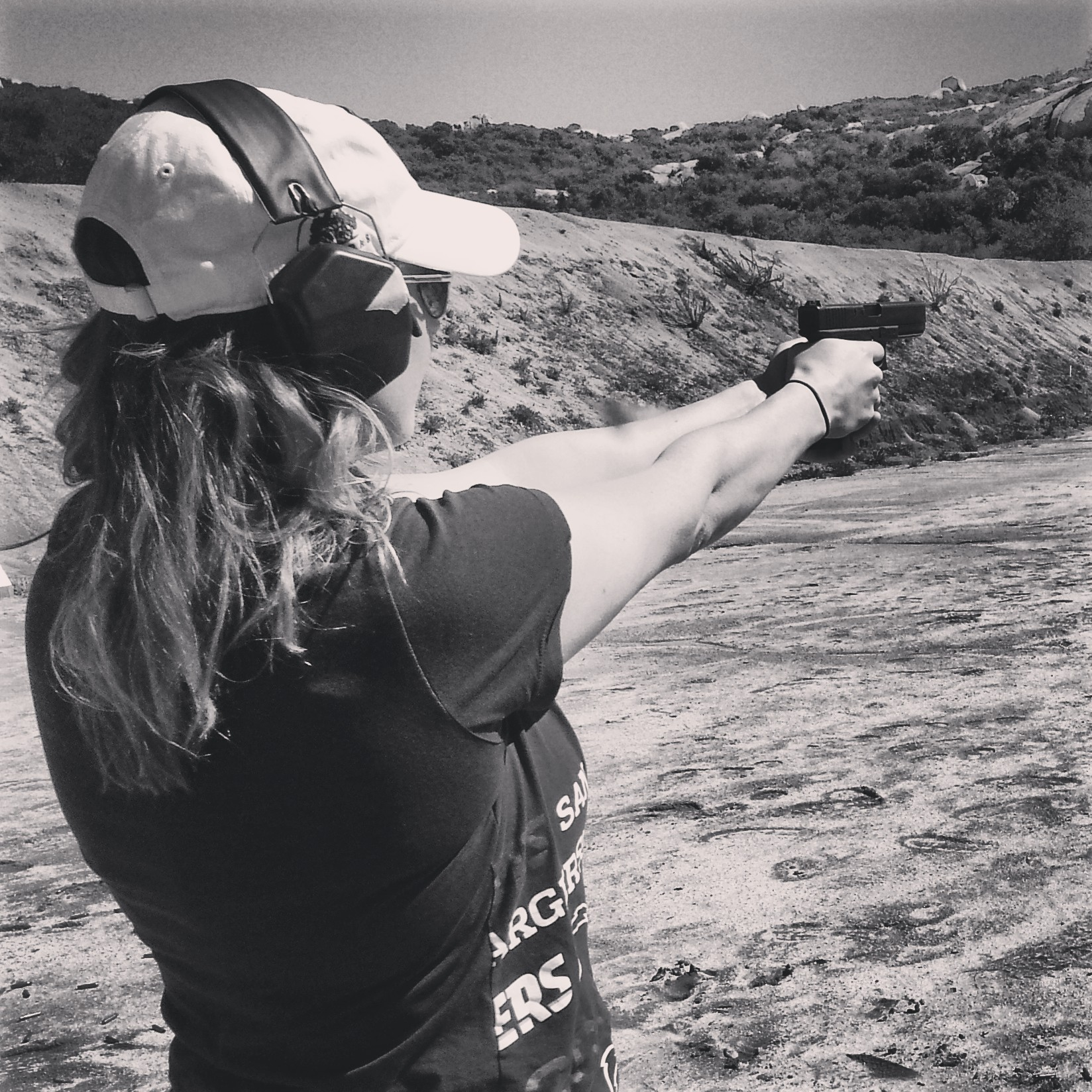 Why More Women Should Own A (Pink) Gun. Shooting range. https://reelcamogirl.wordpress.com/2015/01/13/why-more-women-should-own-a-pink-gun/