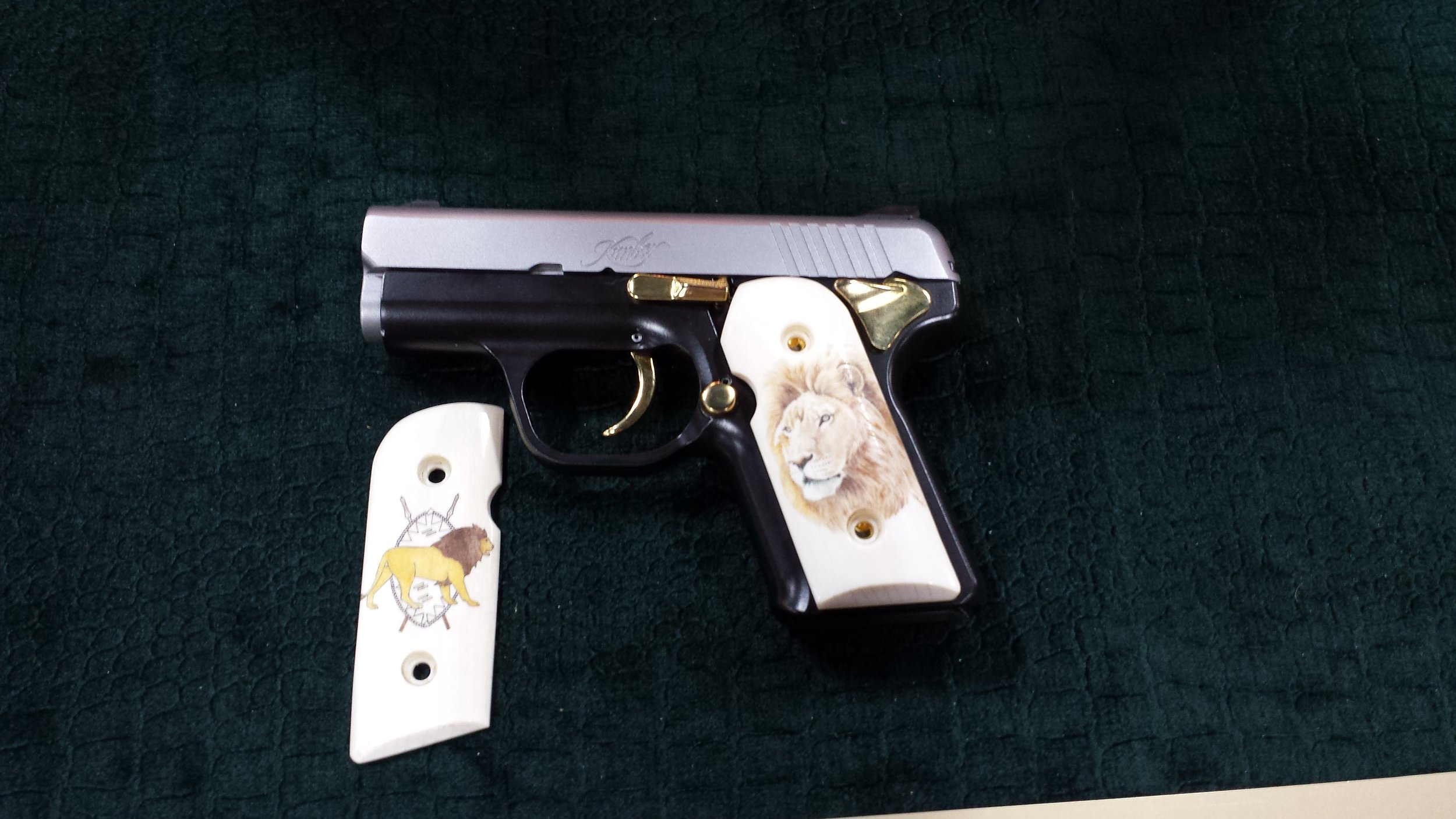 Kimber 9MM pistol with gold inlay REMEMBERING MY FIRST TIME………AT THE SAFARI CLUB INTERNATIONAL LAS VEGAS CONVENTION https://reelcamogirl.wordpress.com/2015/02/17/remembering-my-first-time-at-the-safari-club-international-las-vegas-convention/