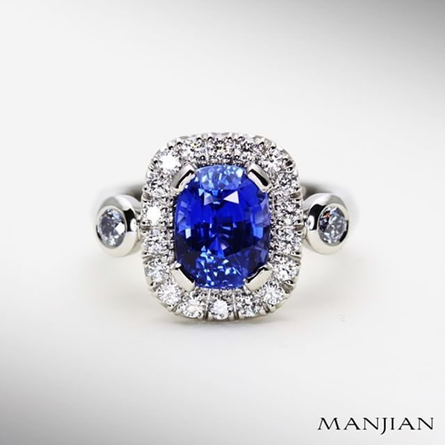 "We were stoked when we sourced this amazing sapphire for an engagement ring order from London. From the top it looks like a luxe modern classic with a micro pave diamond halo and blue Argyle diamond shoulders. To increase the contrast we hand selected D colour diamonds for that extra ""pop"" factor!  #manjiandesign #platinum #handmade #sapphire #argyle #bespoke #ilovesydney #love #sapphireengagementring #ceylonsapphire #sydneylife #sydneycbd #therocks #argylebluediamonds #sydney #jeweller #sydneyjeweller #bespokefinejewellery #sydneylocal #luxe #luxury #argylediamond #benchjeweller"