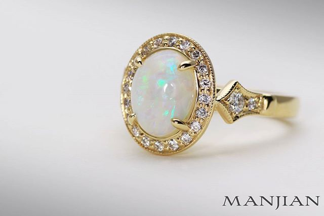 And here's the studio pic. Natural Australian opal engagement ring features milgrained pave set diamond borders and spade shields to create the vintage look and feel.