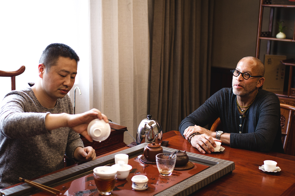 Tea Master Zheng and Nathaniel Vinson at Master Zheng's Tea House in Wuyi Mountain.