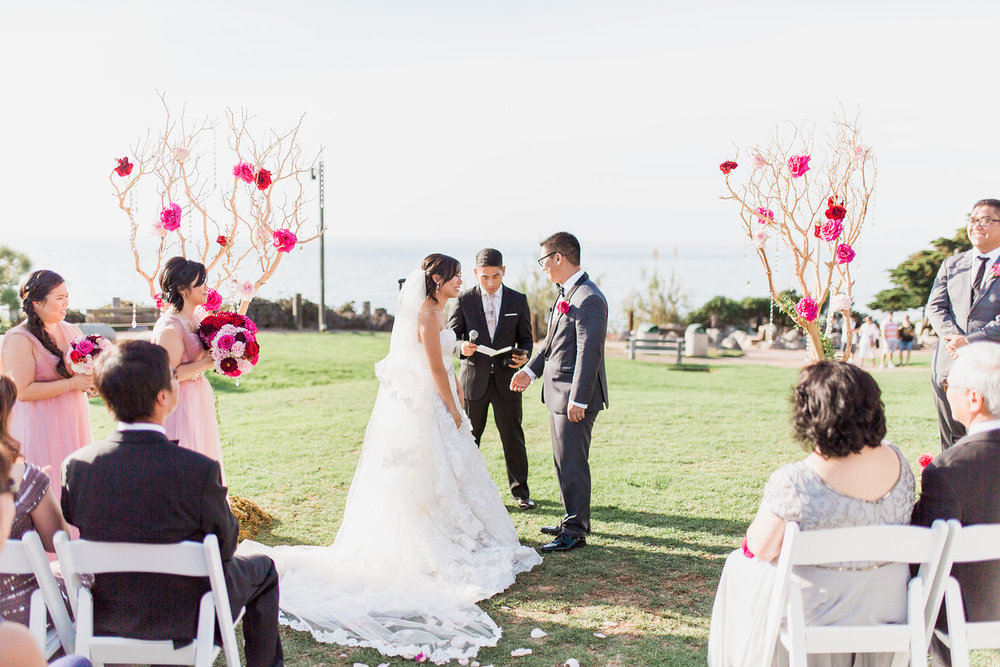 The florist, Organic Elements, provided these two tree branches instead of an arch Photo by: Alex W. Photography
