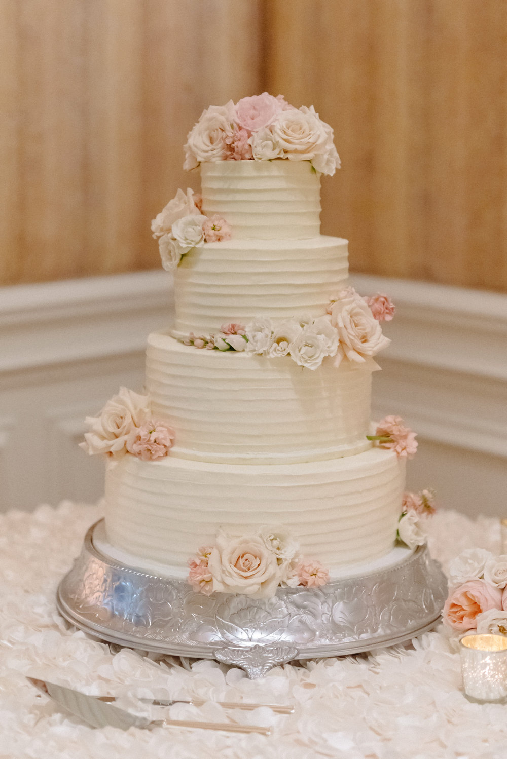 pink florals on white cake