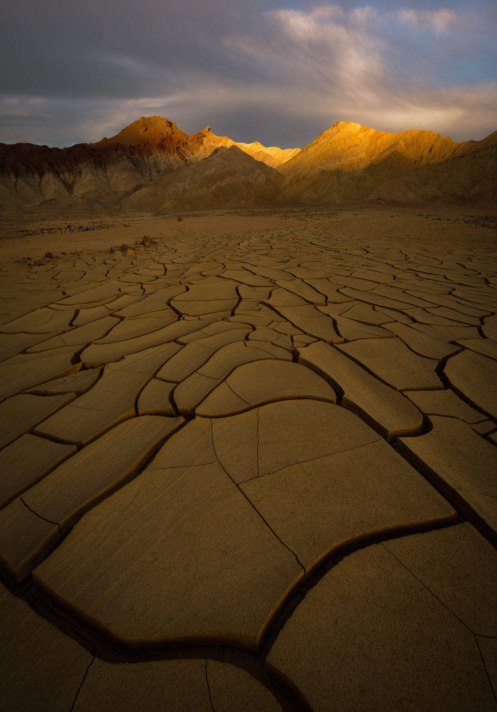 Indescribable mud cracks point to sunset's last light.