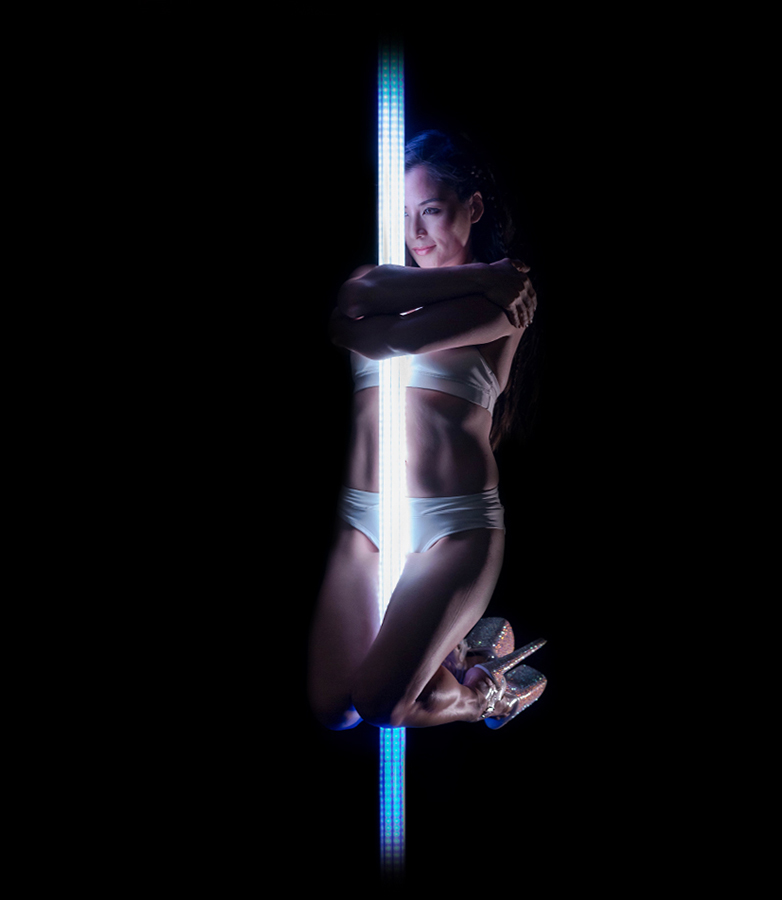 a stunning Duet of pole and dancer - Creating unforgettable performances through dynamic content creation, touch, motion and audio reactivity.