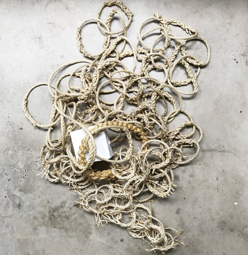 Somewhen, inspired by Gunter's Chain, a tool designed in 1620 to survey and plot land. 100 sisal rope links, plaster and metal leaf (2017)