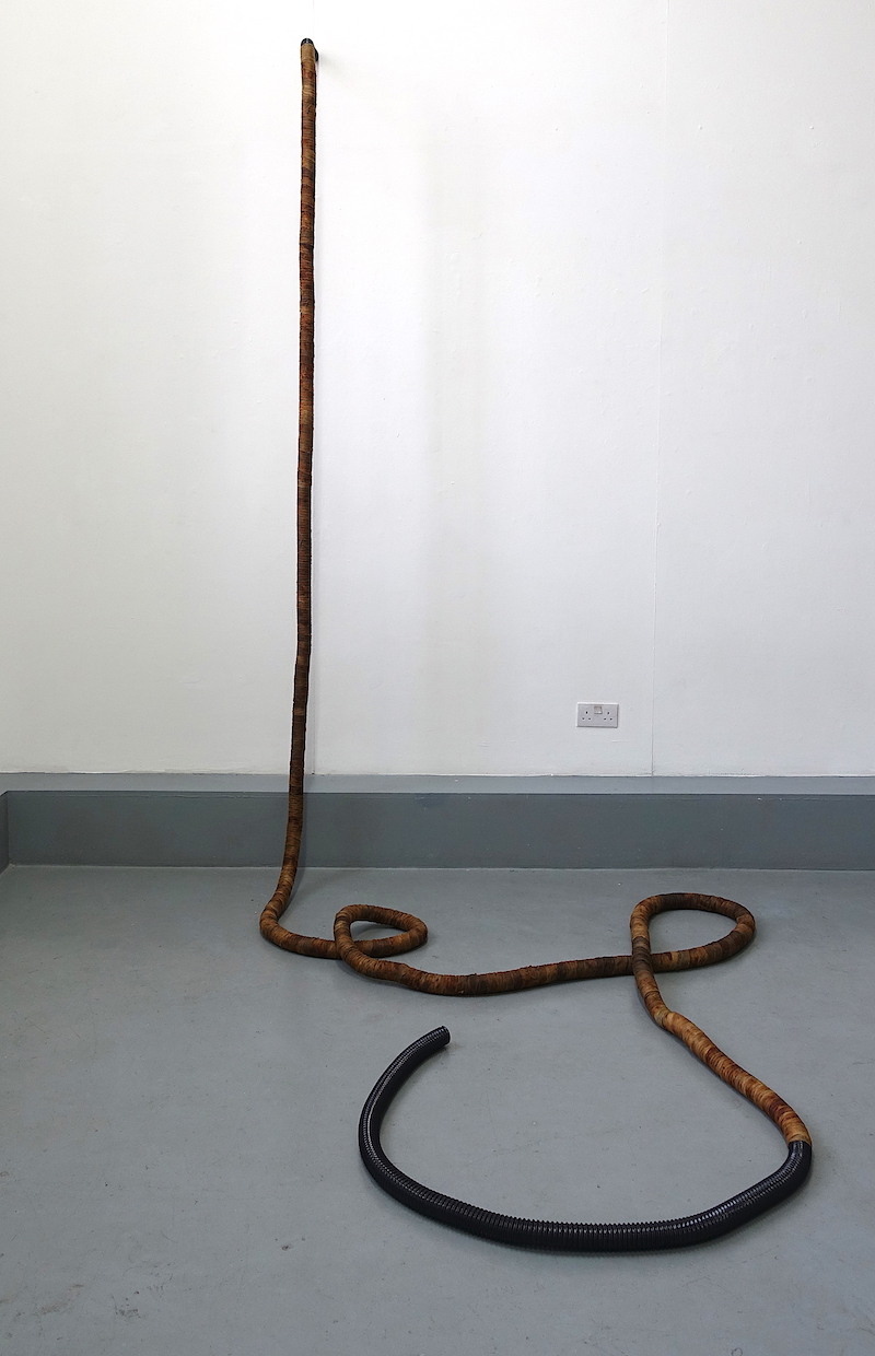 Hermeneutics , 2019 Lewisham Arthouse (Vacuum cleaner hose, rust dyed fabrics)