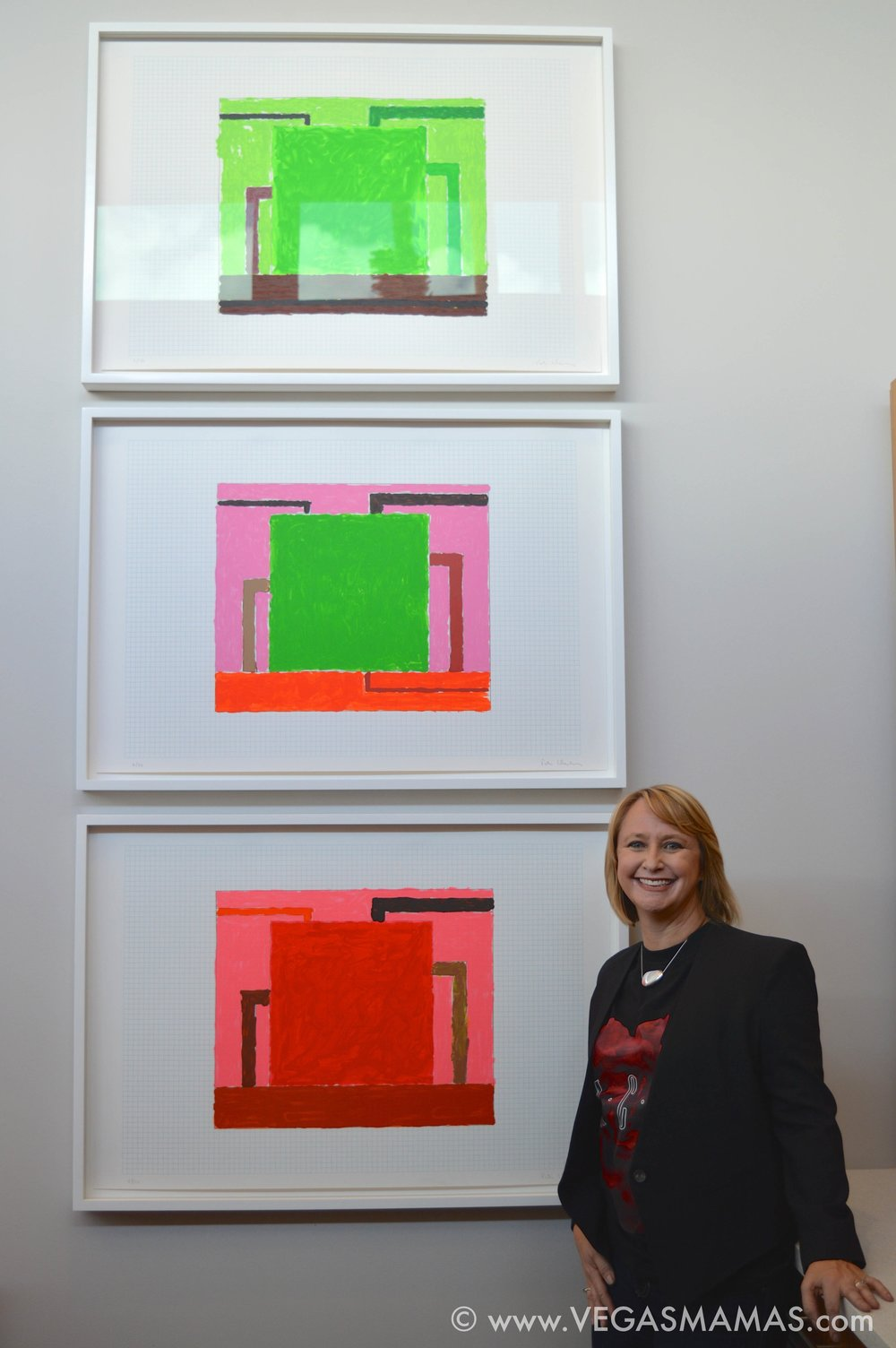 Michele in her kitchen with Peter Halley's triptych