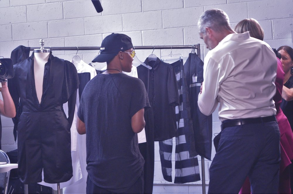 KRIS HARRING presenting their collection to Aaron Hickler - EIC of OUT Magazine and Cynthia Tenhouse of LEXUS