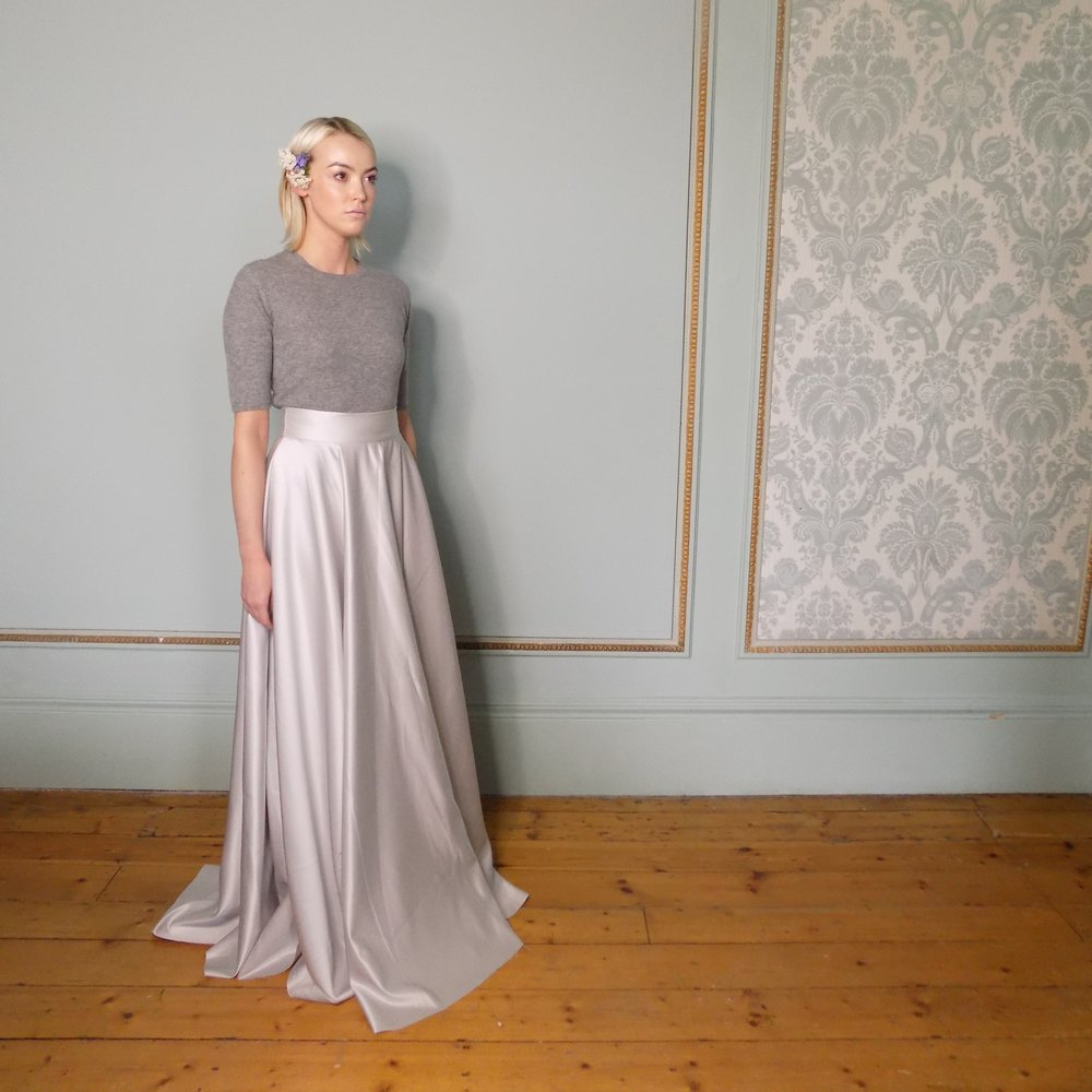 The circle skirt worn with our knitted cashmere t-shirt in grey