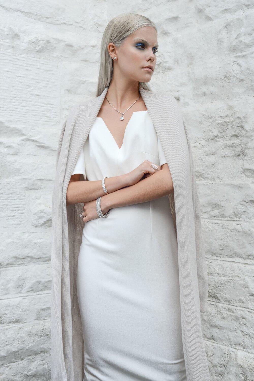 Nina wears: Dress from  Jane Davidson ,  wrap  by Cross Cashmere, diamonds from  Rox
