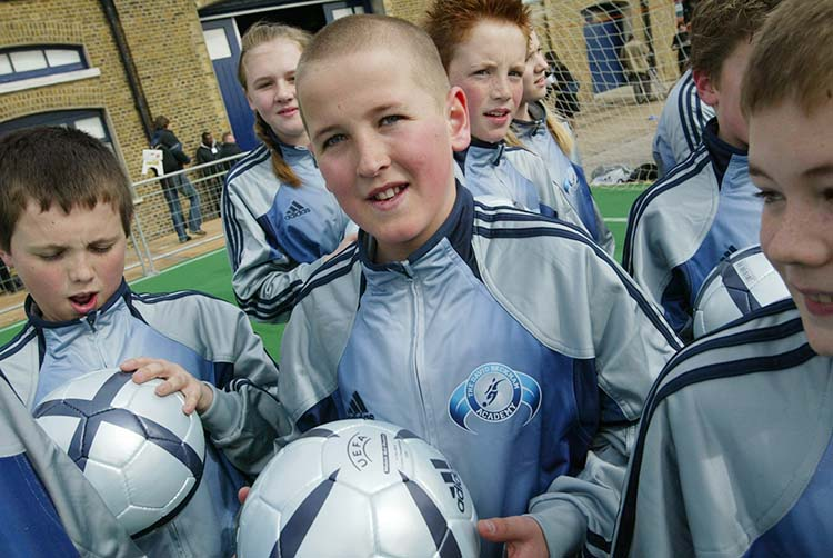 14 March 2005, The David Beckham Academy Launch, The Chainstore, London Current Tottenham Hotspur player Harry Kane (boy with shaved head). Picture: Mooneyphoto