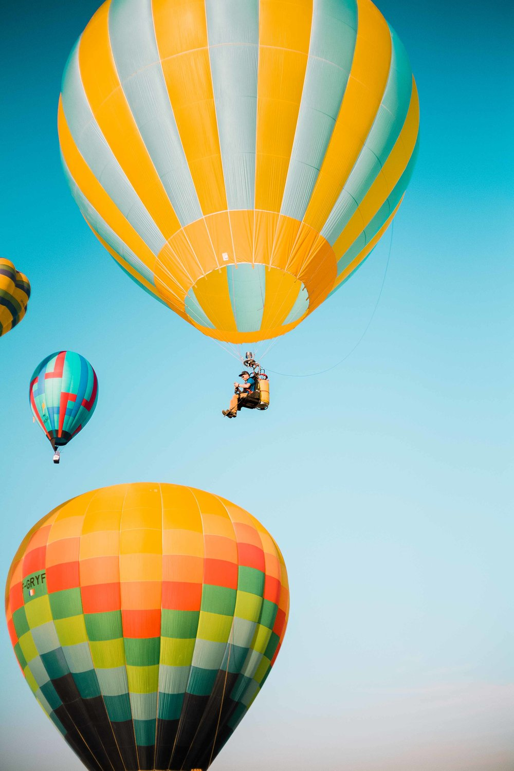 BE WARY OF THE CABLES  When you meet your pilot and his team, they will probably be prepping  the balloons. A high-powered inflation fan will force air into the balloon envelope. Be mindful of the cables and ropes connected to the balloons and the baskets.