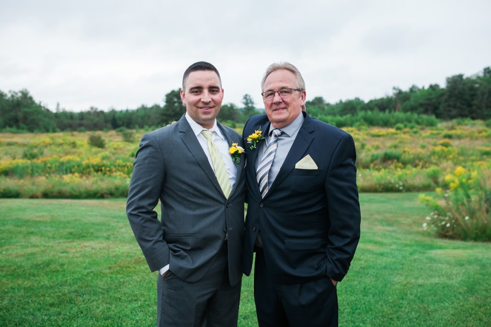 The groom and his proud father.