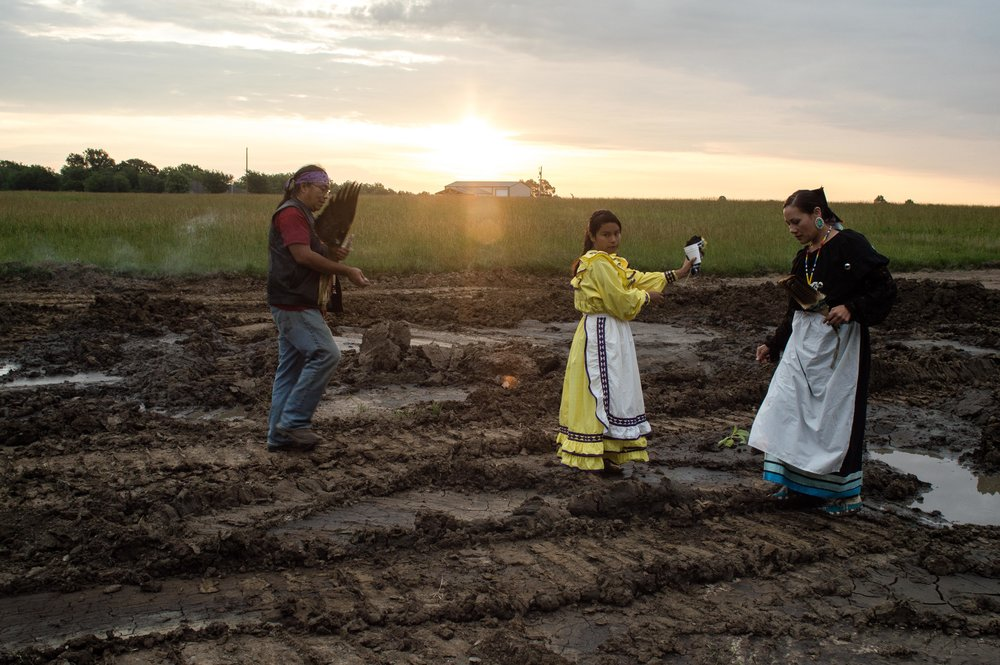 6:35 A.M. (Left) Ben Carnes, Choctaw Elder. (Center) Josephine, Choctaw. (Right) Ashley McCray, Oglala Lakota and Absentee-Shawnee. Planting tobacco in the pipelines path.