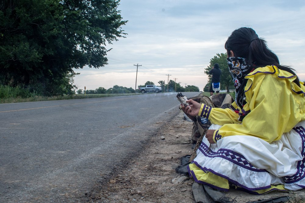 7:42 A.M. Josephine burning Sage as pipeline workers watch and take pictures from their truck.