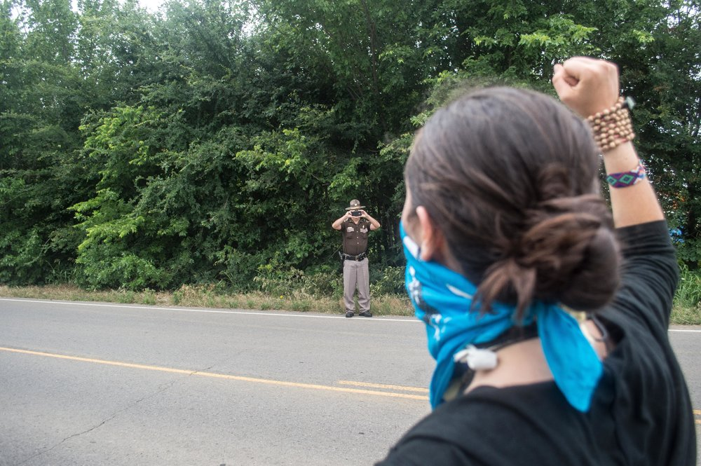 8:32 A.M.  The press photographs the Police who photograph the protesters who photograph the police.