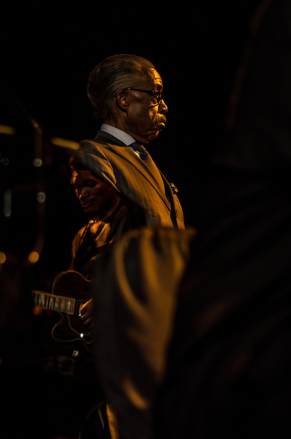 May 10, 2017. 8:02 P.M.  Al Sharpton prepares to take the stage at the Prayer and Call for Justice Rally.  Downtown Tulsa.