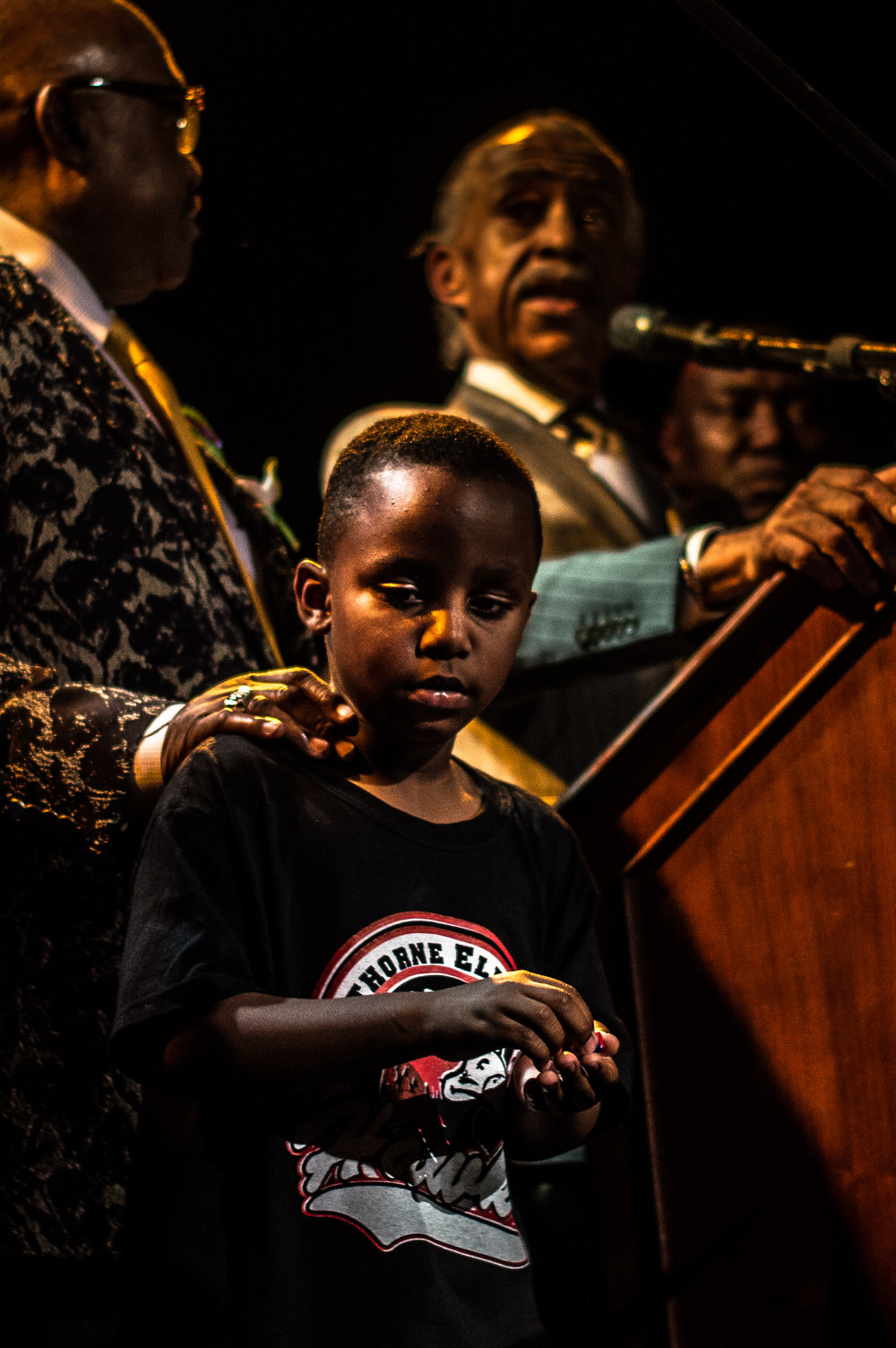 May 10, 2017.  8:34 P.M.  Terence Crutcher's 4 year old son on Stage with Al Sharpton at the Prayer and call for Justice Rally.  Downtown Tulsa.