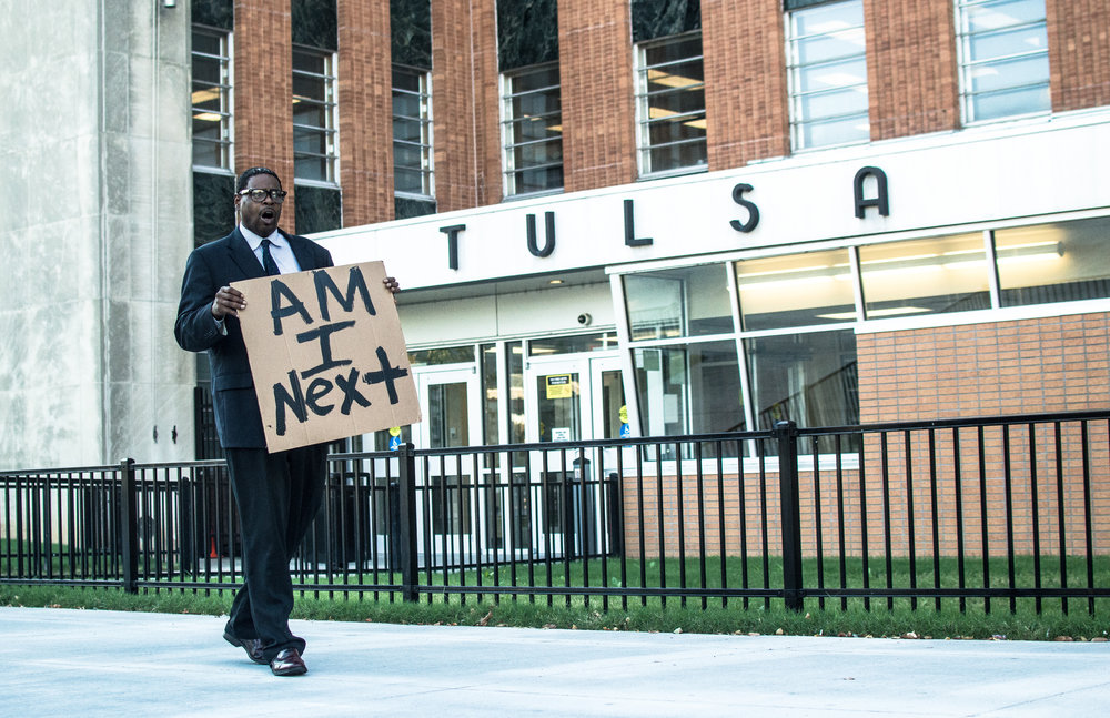 September 19, 2016.  8:23 A.M.   Markus Whited in front of the Tulsa District Courthouse in downtown Tulsa, OK.  Terence Crutcher was shot and killed on Friday evening, September 16.  Markus was with a group of 7-8 people who showed up to the first rally on the Monday after the shooting.