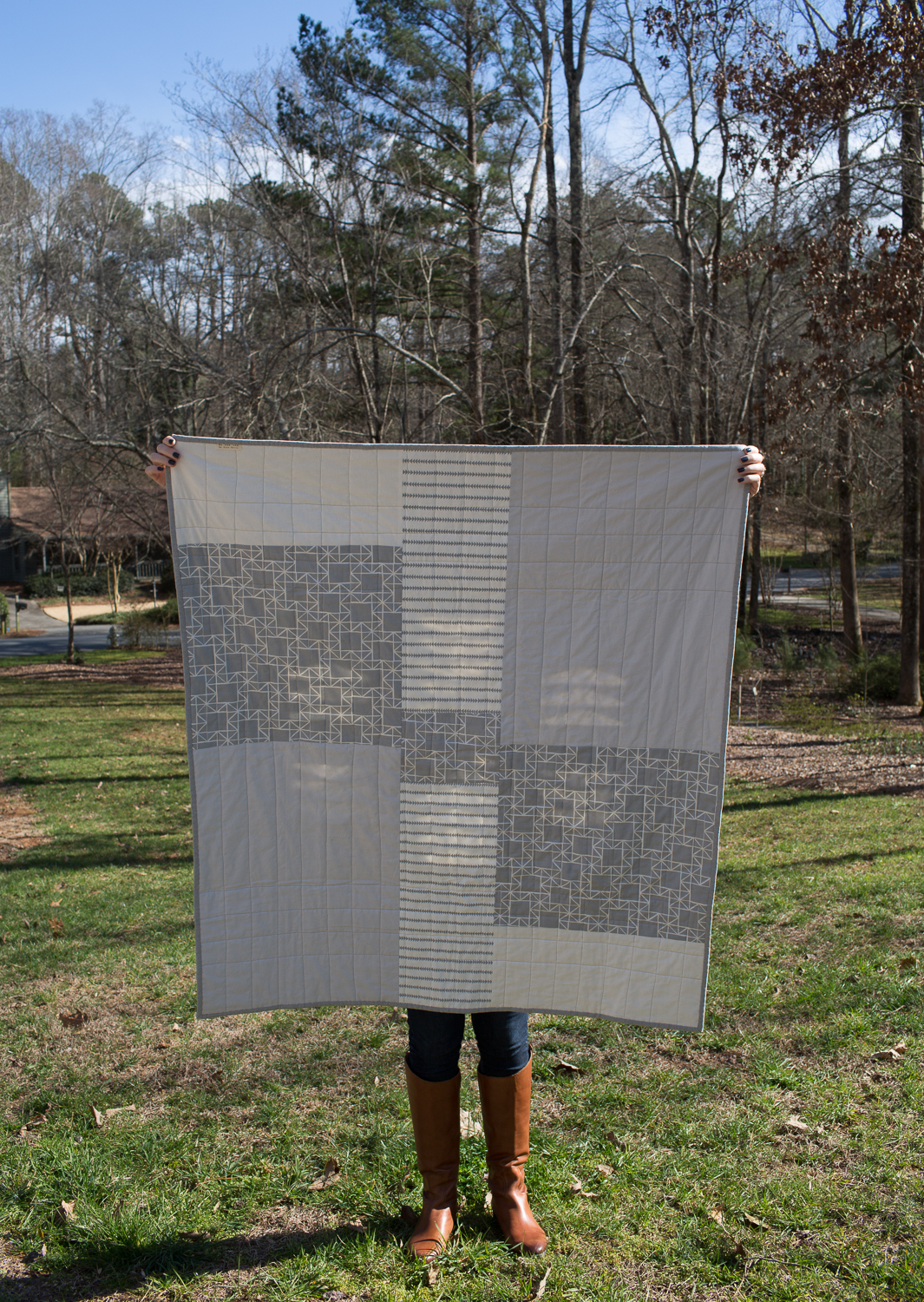 The back was pieced with greyscale fabrics from my stash, including some Kona solids and Ellen Baker prints, in fitting geese and geometric squares.