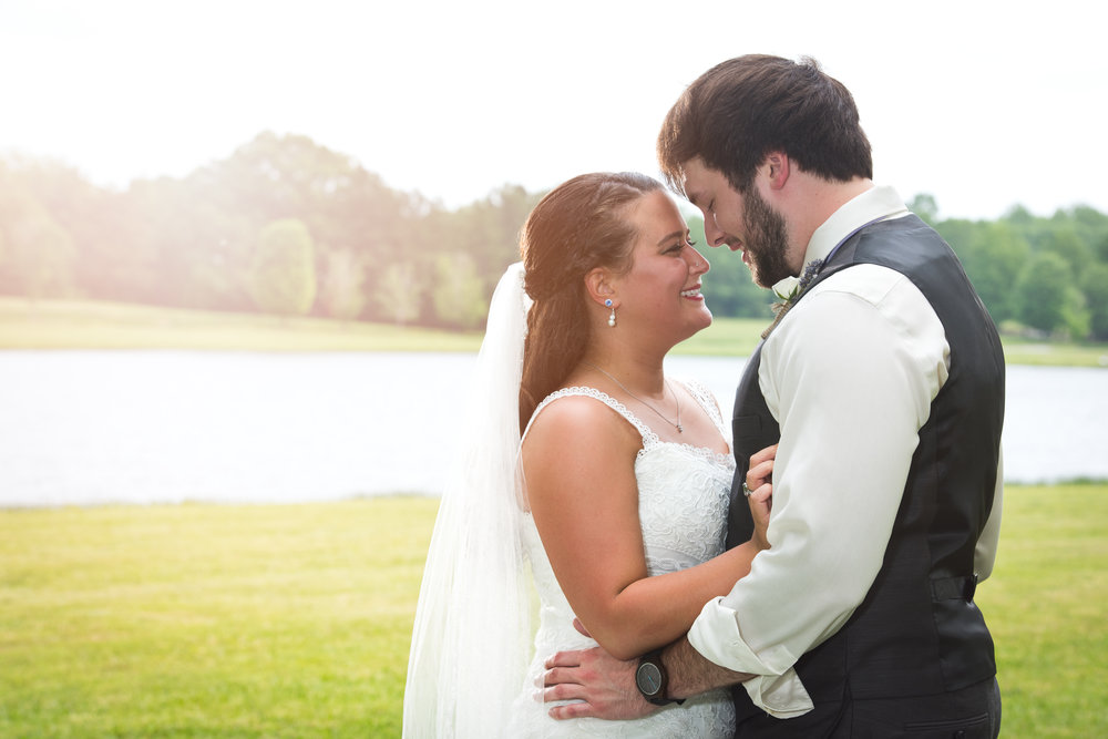 amber and craig married at the oaks wedding venue with premiere party entertainment dj disc jockey for ceremony and reception in anderson near greenville spartanburg south carolina michelle conley wedding coordinator Noveli photography my wedding group hollys cakes holly's amy cromer florist