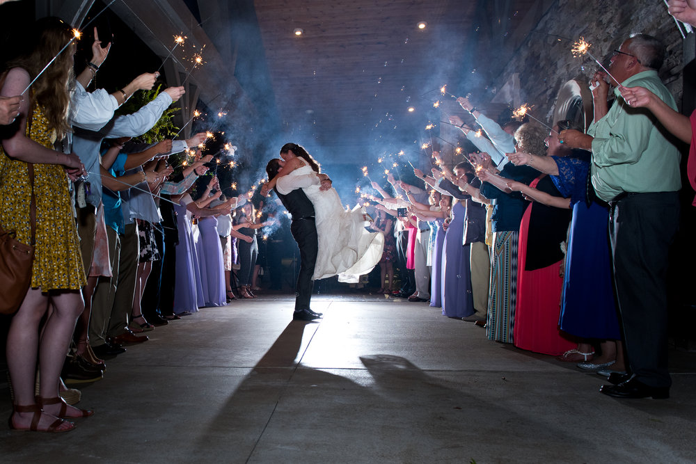 famzing love novelli photography greenville anderson spartanburg south carolina SC photo booth up lighting sparkler exit the oaks wedding venue