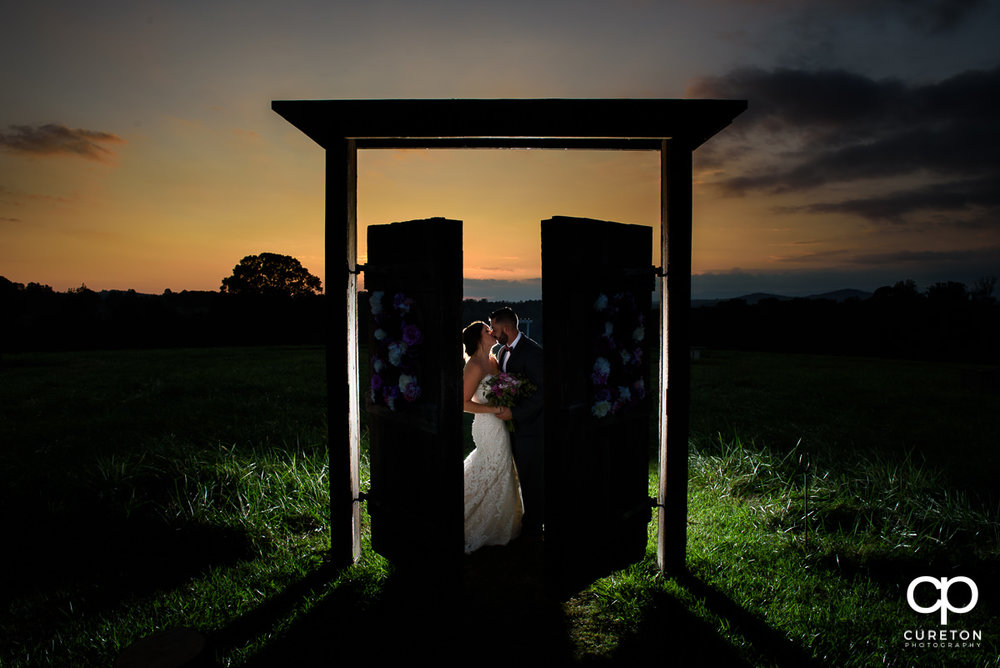 Mr & Mrs Black Lindsey Plantation Taylors SC Wedding Ceremony & Reception DJ greenville spartanburg anderson sc wedding entertainment photo booth uplighting monogram lighting professional wedding dj sc john cureton photography upstate sc barn doors sunset photos wedding engagement pictures barn doors