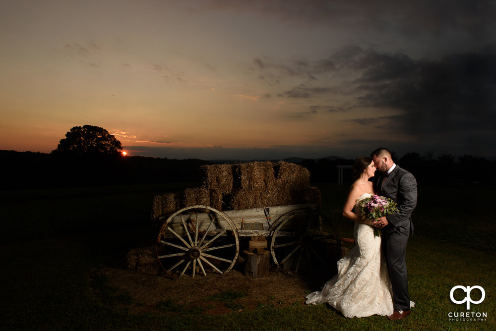 Mr & Mrs Black Lindsey Plantation Taylors SC Wedding Ceremony & Reception DJ greenville spartanburg anderson sc wedding entertainment photo booth uplighting monogram lighting professional wedding dj sc john cureton photography upstate sc hay field barn sunset engagement photos wagon