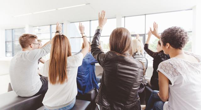 group-meeting-raising-hands.jpg