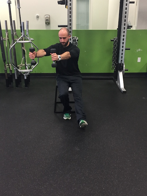 Reaching DB's over your working leg when lowering down still serves as a counterbalance, but also shift your center of mass more over you base of support and will allow you to feel more stable.