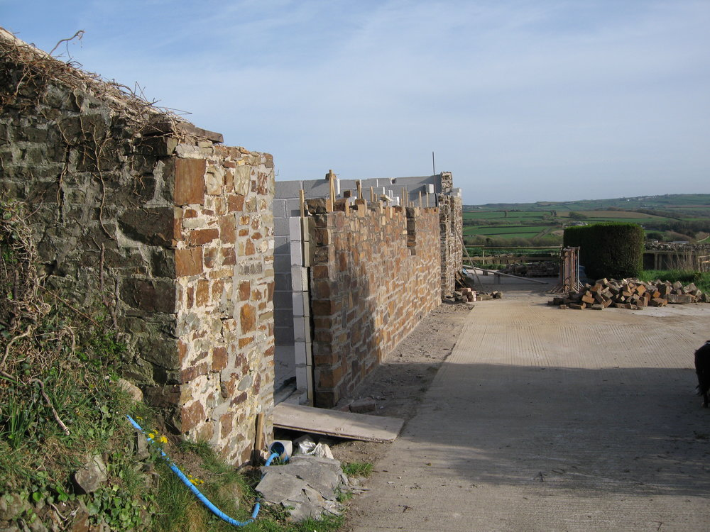 Building up the walls of Wenna's Well and Buttermilk Barn