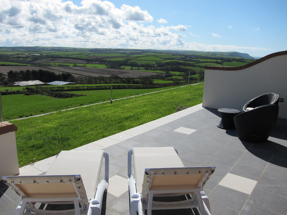 Patio area loungers with views of the rolling countryside