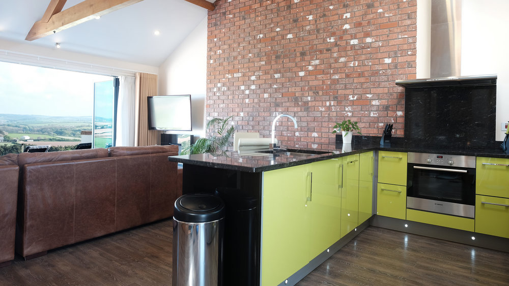 Modern lime green kitchen with granite worktop