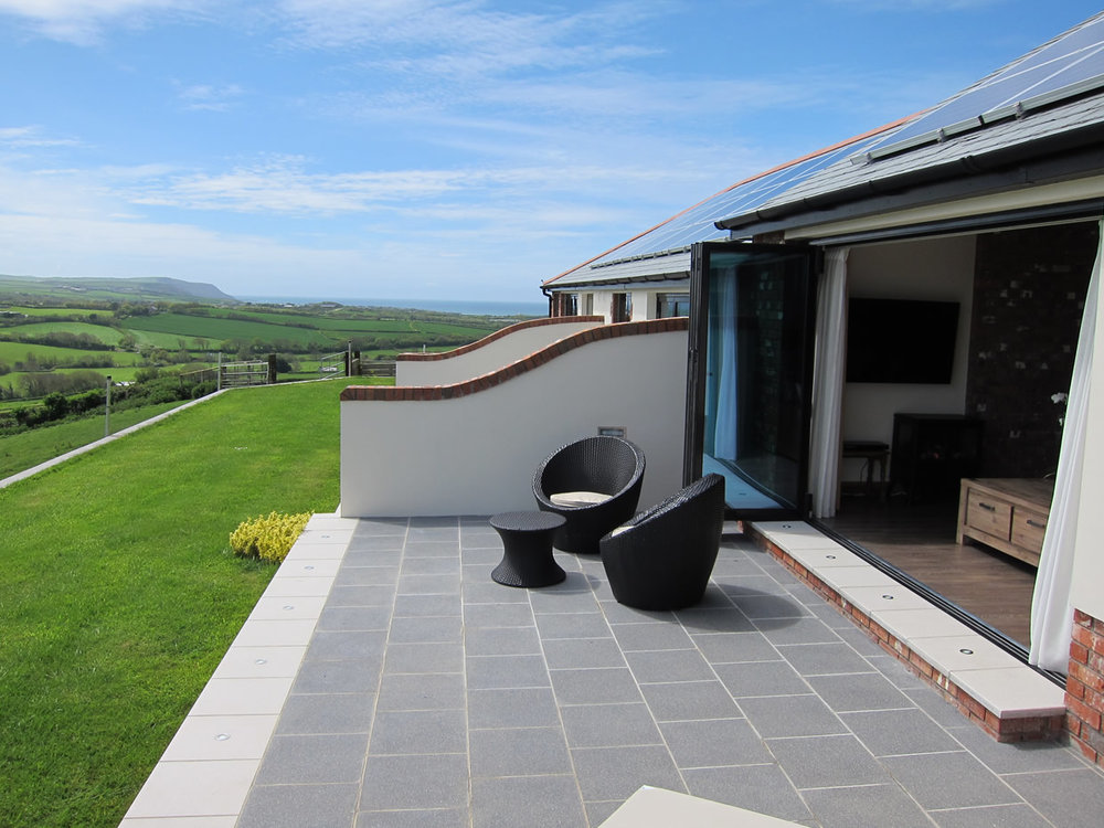Patio with far reaching views to the sea