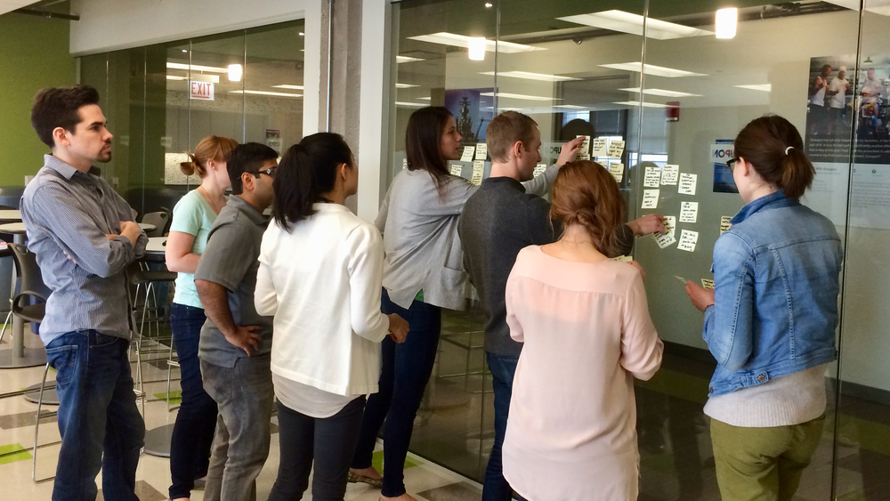 Multiple teams discussing what they discovered during their field visits to local small businesses.